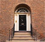 Elegant black arched entrance door