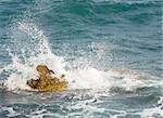 Stony sea coastline  and wave with splashes