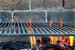 Bar b cue barbecue fire BBQ coal fire iron grill brick wall