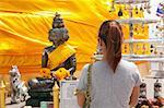 woman worship budda in the temple thai,worship thai faith budda