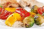 grilled vegetables with mushroom sauce and pork steak
