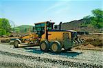 scraper the building road machine at  work