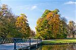 Bridge in the Nymphenburg autumn park in Munich, Germany