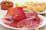 some spanish tapas, as tortilla de patatas, serrano ham and olives