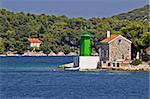 Green lighthouse - lantern in bay entrance, Mali Losinj, Croatia