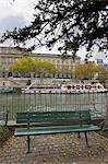 France, Paris, garden of pont neuf and barges along quai de Conti