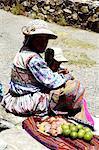 Peru, Colca canyon, woman selling fruits