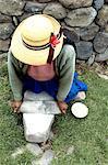 Peru, Sillustani, making quinoa meal