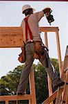 Carpenter nailing wall frame