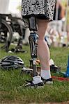 Woman with prosthetic leg preparing for bike race