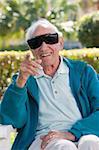 Senior man wearing cataract dark glasses
