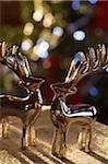 Reindeer shaped metal ornaments in sunset