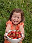 toddler girl in vegetable garden