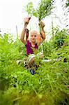 Girl harvesting organic carrots.
