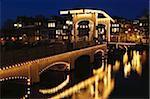 Netherlands, Amsterdam, bridge illuminated at night