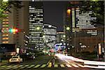 Japan, Tokyo, Shinjuku Ward, street scene and office blocks at night