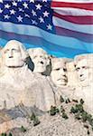 USA, South Dakota, Mt. Rushmore National Monument and American flag