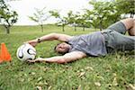 Man saving soccer ball in goal, ground view