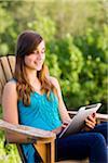 Teenage Girl Using iPad Outdoors