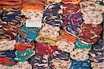 Morocco, Marrakesh, rugs stacked in market (full frame)