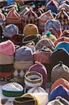 Morocco, Marrakesh, woven hats on market stall