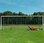 Mature football goal keeper defending goal