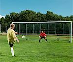 Mature men playing football