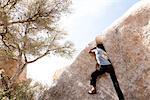 Rock Climber Free Climbing