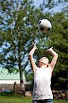 Girl Throwing Football Above Head