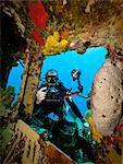 Underwater photographer on wreck