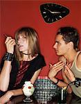 Teenage Boy Sitting Next to Girl Who Ignores Him as She Eats a Fruit Cream Sundae