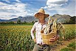 Portrait of Farmer Holding Basket on Organic Farm