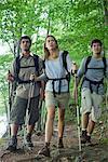 Friends hiking in woods