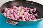 Preparing shallots in pan