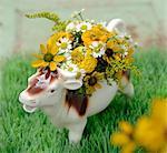 Cow figurine with flowers