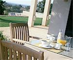 Laid breakfast table on terrace