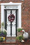 Flower wreath at front door