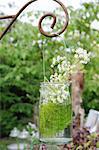 Flowers in a glass in garden