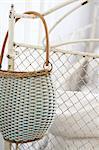 Handbag hanging at bedpost