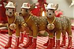 Three Christmas deer figurines standing in row