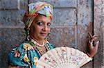 Cuba, Havana, woman holding fan, portrait