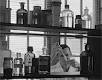 1960s MAN SCIENTIST CONDUCTING EXPERIMENT TEST TUBE LIQUIDS