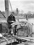 1910s OLD MAN FISHERMAN REPAIRING FISH NETS ON THE DOCK WESTPORT CONNECTICUT