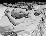 1930s SLEEPING BLOND WOMAN HAND OVER HEAD ASLEEP
