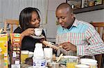 Kenyan couple sharing breakfast, Nairobi, Kenya