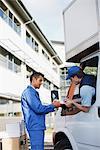 Deliveryman signing clipboard
