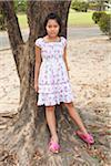 Girl Leaning Against Tree, Bangkok, Thailand