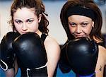 Portrait of two women wearing boxing gloves