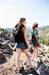 Women overlooking landscape from hill