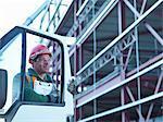 Construction worker opening car door